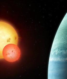 The newly discovered planet (right) orbits a pair of suns.