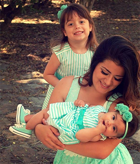 Vanessa Cardenas shares a sweet moment with her daughters.