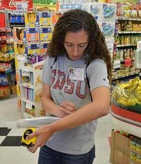 SDSU masters of public health graduate Christina Olson collects nutritional data in a market.