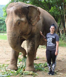 Senior Tori Parker stands next to an elephant in Thailand. (Photo: Tori Parker)