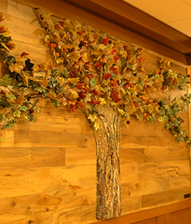 Artist Aida Valencia created a glass and stone mosaic of the sycamore tree that grew in Aztec Center.