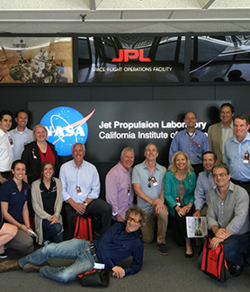 The SDSU Los Angeles Regional Council poses at mission control at the NASA Jet Propulsion Laboratory. (Photo: Jimmy Steinfeldt, Tari Weiss)