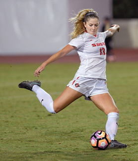 SDSU defender Stacie Moran kicks the ball against San Jose State in the Mountain West Tournament semifinals. (Photo: Ernie Anderson)