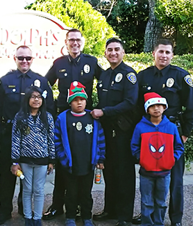 Members of the SDSU Police Department helped children select gifts at Target. (Photo: Michelle Peterson)