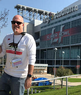SDSU Director of Athletic Bands Bryan Ransom poses in front of NRG Stadium prior to Super Bowl LI. (Credit: Bryan Ransom)