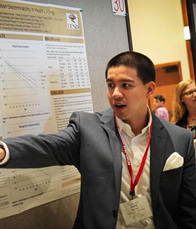 An SDSU student discusses his research at last year