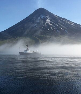 R/V Oceanus anchored near Chuginadak Island. (Photo: Genoa Sullaway)