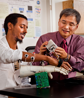SDSU student Ahmed Abdi (left) and professor Kee Moon (Photo: Jeffrey Brown)