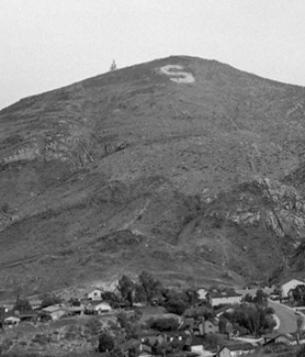 "The ""S"" symbol appears on Cowles Mountain with the San Carlos neighborhood below. (Credit: SDSU Special Collections and University Archives)"