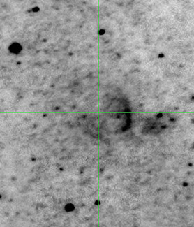 Crosshairs indicate the location of the nova studied. Remnant can be seen as a partial arc to the right of the nova.