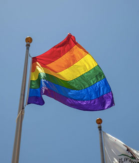 Image shows pride flag during annual pride flag raising ceremony in 2018.