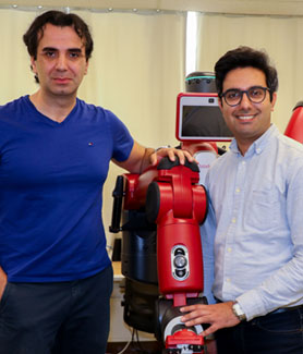 Robotics researcher and assistant professor Peiman N. Mousavi (left) with his student Mostafa Bagheri and the robot they worked on. Photo and video: Scott Hargrove for SDSU