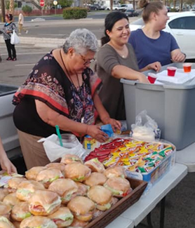 SDSU Imperial Valley student affairs advisor Norma Aguilar and students Tiffani Escalante, Viviann Ceseña and Ana Fernanda Lizarraga volunteering at meal service.Photo: Maribel Padilla for Brown Bag Coalition