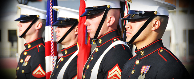 Color Guard members stand at attention following Pass-in-Review.