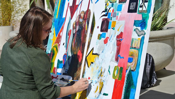 Students created unique art pieces and collectively contributed to a canvas mural during the Week of Caring.
