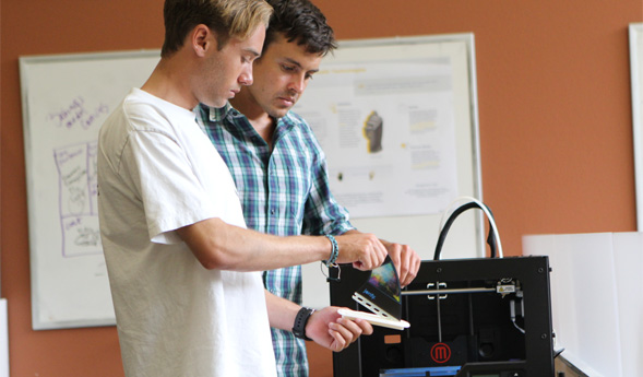 Students work with the 3-D printer in the Zahn Innovation Center.