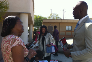 Trimaine Davis speaks with family during Super Sunday event