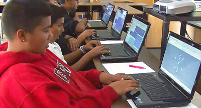 Castle Park Middle School students using laptops