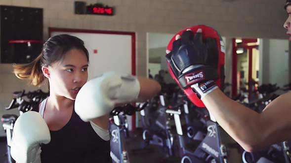 Karyna Yoong kickboxing at the Aztec Recreation Center