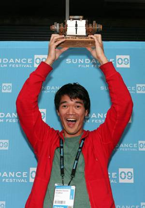 Destin Daniel Cretton hoists high his U.S. Jury Prize for best short film.