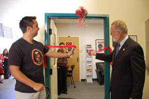 SDSU Student Veterans Organization President Ivo Moreno and SDSU President Stephen L. Weber ceremonially cut the ribbon, opening the new center.