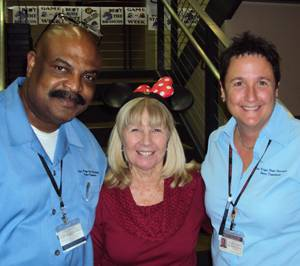 Linda Stewart (middle) dons mouse ears with her Business and Financial Affairs colleagues, Chief John Browning (left) and Debbie Richeson.