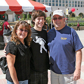 photo: parents and their son attending Family Weekend