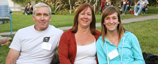 photo: Parents and their daughter enjoy Family Weekend