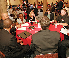 photo: students and professionals at a networking event