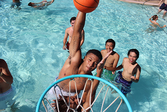photo: students playing basketball in pool