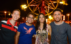 4 students at carnival during aztec nights