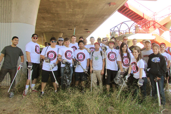 photo: students pose at the river clean-up site