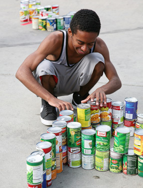 photo: student working on the can-struction