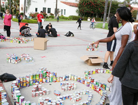 photo: student directs can-struction arrangement