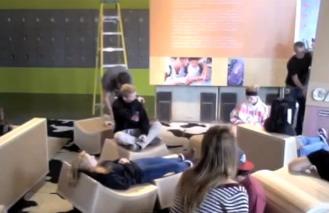 Photo: students setting up cardboard lounge