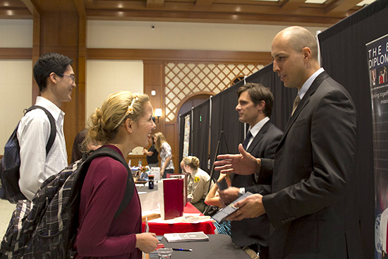 photo: female student talking to guy at career fair