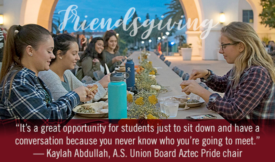 students gathering at friendsgiving dinner