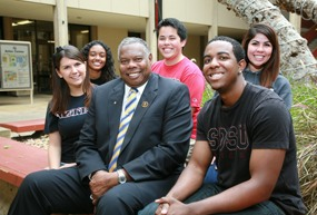 Dr. Kitchen poses with students