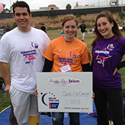 Three Student volunteers holding Relay for Life sign