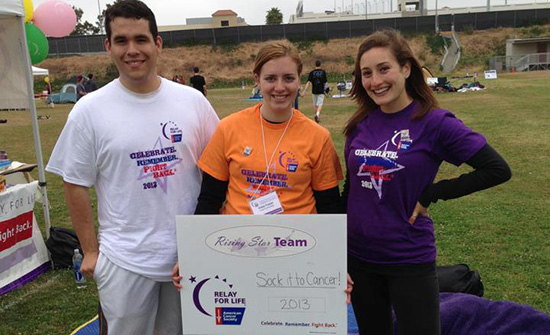 Volunteer Students holding Relay for Life sign
