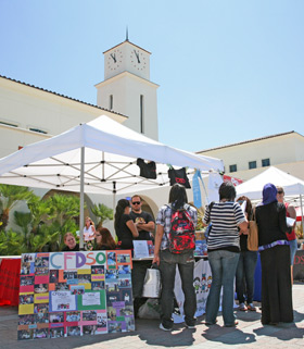 photo: students attend a club fair on campus