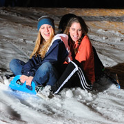 photo: students sledding in the snow