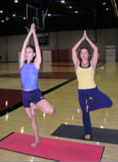 Photo: Two students in yoga pose at Aztec Recreation Center
