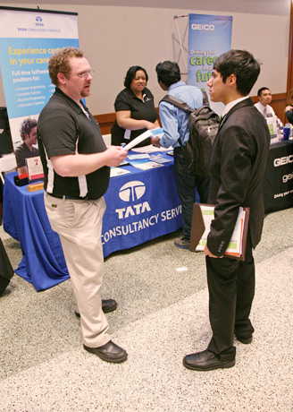 photo: employer and student at a career fair