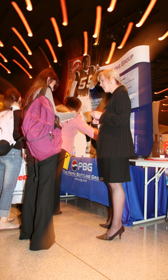 photo: a student speaks with an employer at a career fair
