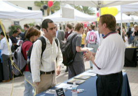 Photo: Student and employer at career fair