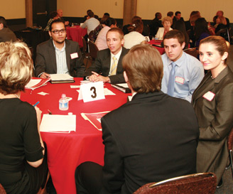 photo: students and employers at a networking breakfast