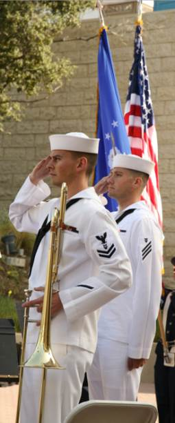 Photo: Two military band musicians salute