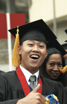 Photo: SDSU graduate in cap and gown