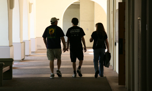 photo: silhouette of a student with their parents